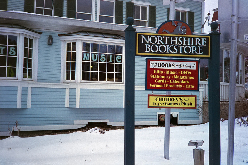 Northshire Bookstore.  Manchester, VT.  On my way back to the warm car. <br /> I wanted to take this picture from the median between lanes, but a lady immediatly stopped her car and motioned me to cross.  So I had to cross.  Which is why this was taken too close.<br /> (Film)