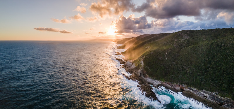 Panoramic aerial view of Otter Trail cliffs sunset, Eastern Cape, South Africa