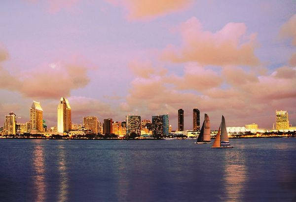 San Diego Convention Center and Americas cup sailboats at sunset
