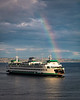 Rainbow greets a ferry arriving in Eagle Harbor on Bainbridge Island