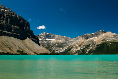 Bow Lake displays a certain starkness in the bright summer sun.