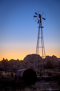 The abandoned Desert Queen Well windmill & pump at sunset - Joshua Tree National Park
