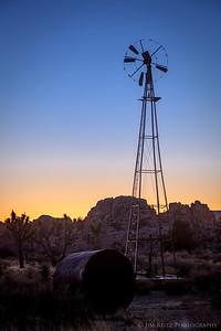 The abandoned Desert Queen Well windmill & pump at sunset - Joshua Tree National Park