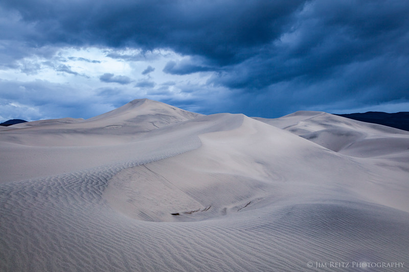 Dark & moody clouds above the Eureka Dunes in Death Valley. You can spend hours here (and we did) searching for pleasing lines and curves in the sand.
