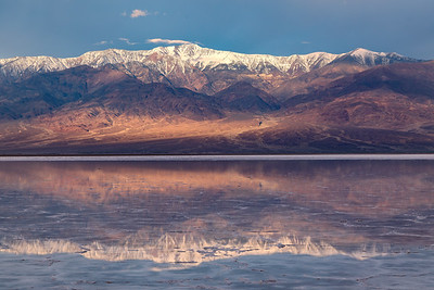 Telescope Peak and the Panamint range reflected on the water-covered Badwater Basin salt flat.