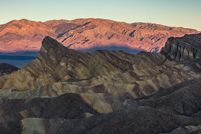 Sunrise on distant mountain range - Zabriskie Point, Death Valley National Park