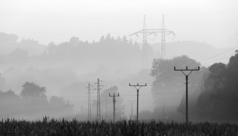 Poles of high voltage in landscape, sunset time.