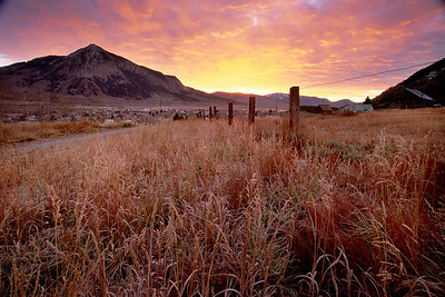 Sunrise behind Mt Crested Butte from Treasury Hill