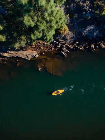 Aerial view woman on yellow kayak on Bulshoekdam Dam, Western Cape, South Africa