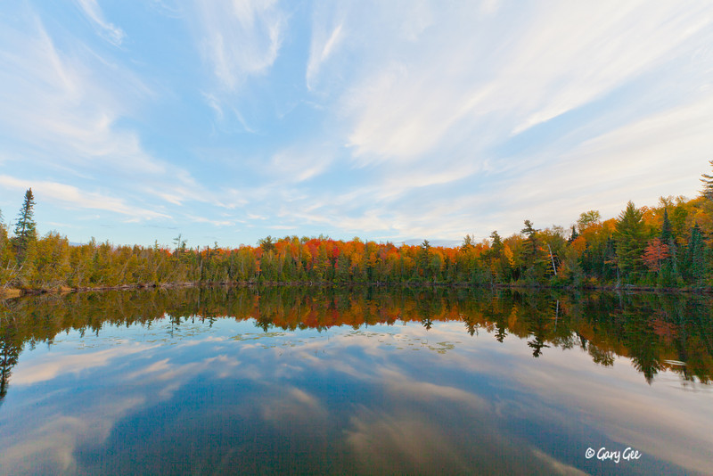 Great Clouds in this fall reflection near Marquette Michigan Fall Color