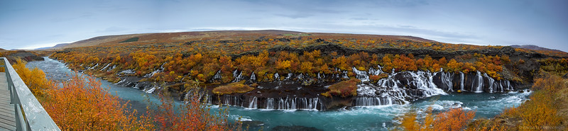 Hraunfossar (Lava Falls) in west-central Iceland. Water flowing beneath a lava plain gushes out in a series of waterfalls over a half-mile long.