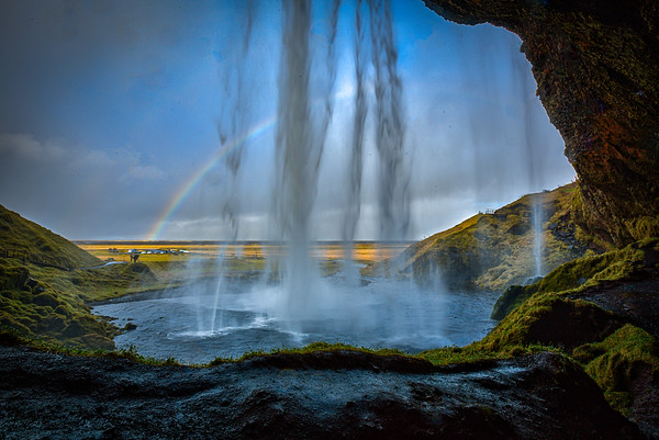 Seljalandsfoss waterfall in southern Iceland. Unique because you can walk behind the falls to get this view looking out to the plains beyond.