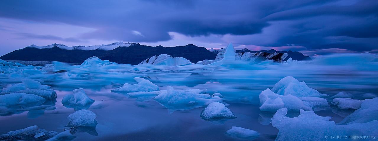 Twilight iceberg races, on the Jökulsárlón glacier lagoon in eastern Iceland.