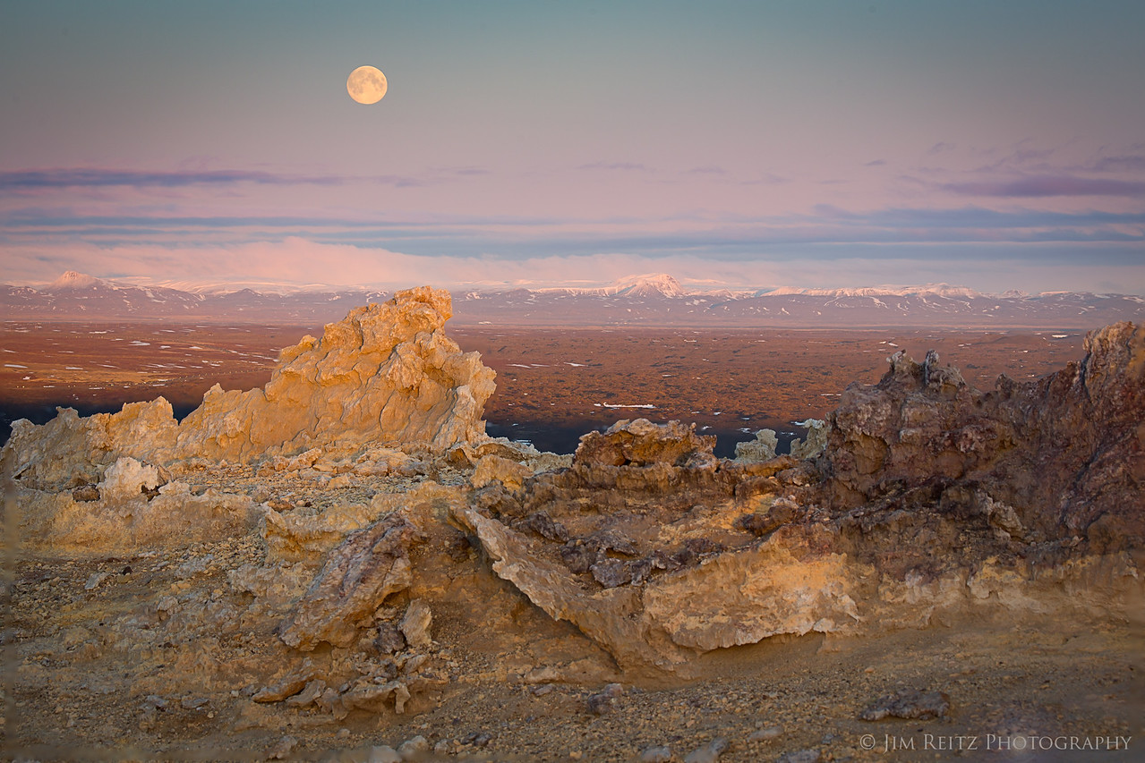 The full moon rises over the Icelandic plains east of Namafjall ridge, in northern Iceland.