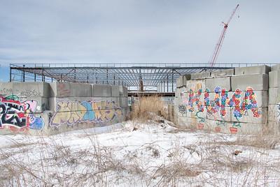 Cinder blocks, graffiti and steel framework for the new store