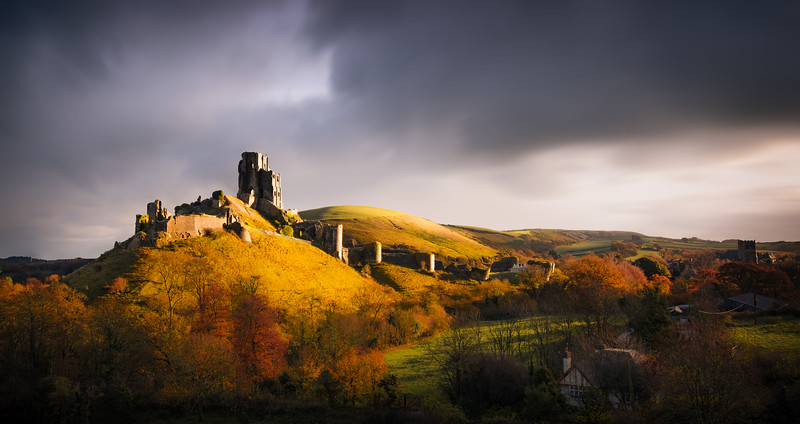 Corfe Castle is a fortification standing above the village of the same name on the Isle of Purbeck in the English county of Dorset and is one of Britain's most iconic survivors of the English Civil War.