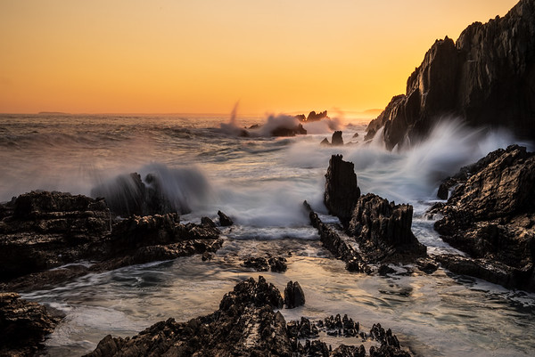 Otter Trail waves crash against rocks at sunset, Eastern Cape, South Africa