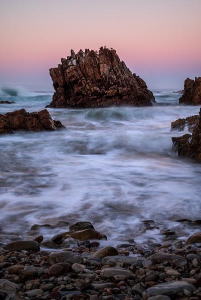 Otter Trail waves crash against rocks at sunrise, Eastern Cape, South Africa