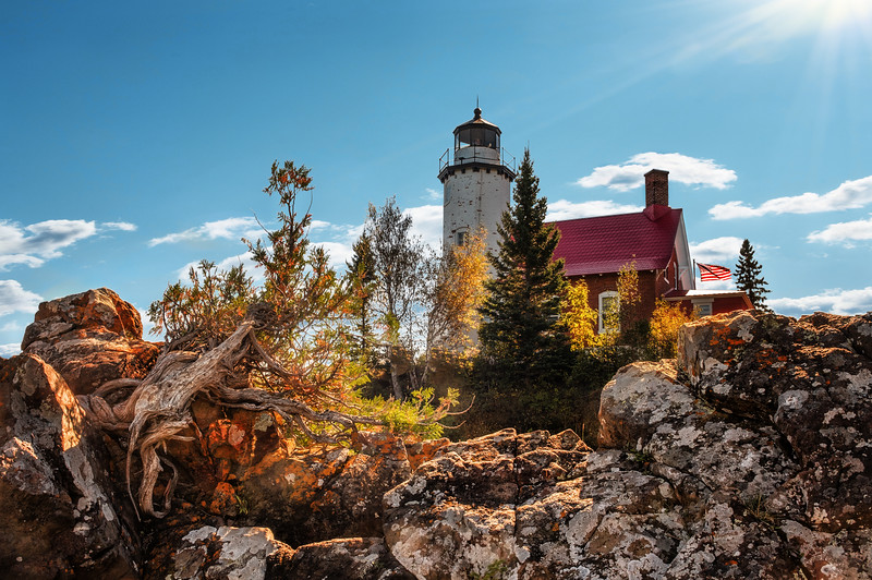 Eagle Harbor Lighthouse was originally built  in 1851. The wooden tower which housed  a fourth-order Fresnel lens was illuminated with a sperm oil lamp soon deteriorated, and in 1871 it was replaced by the present brick structure. A fog signal was added in 1895 <br /> In 1968, the original lens was replaced by aviation beacon-type white and red lights, which could be seen more than 20 miles offshore.  the lighthouse became automated in 1980.