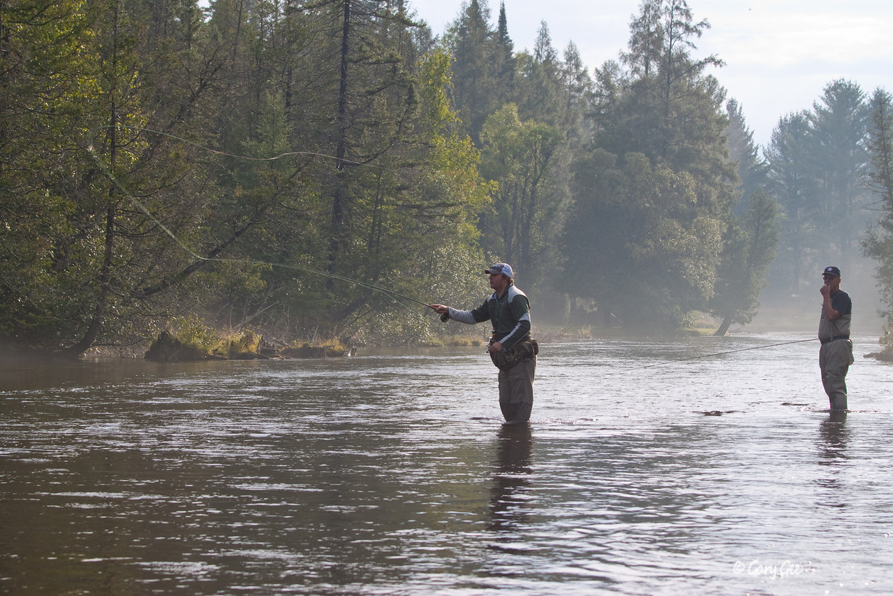 "fisherman trying to pinpoint that cast to the bubble pool at the end of a log jam.....""fish on!"""