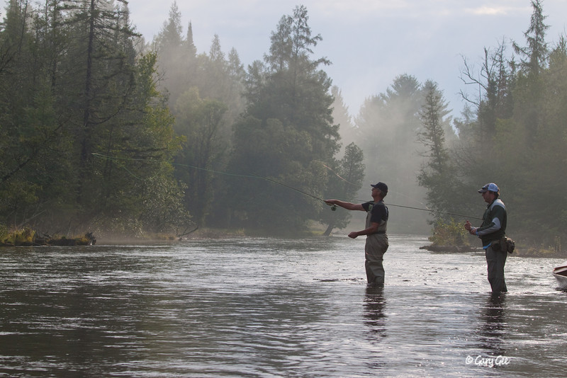 "Casting to that ""Honey-hole"" on the Au Sable River just after a early morning thundershower past by"