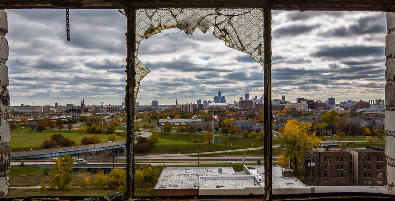 Detroit City Skyline through the broken windows of the Fisher Body Plant