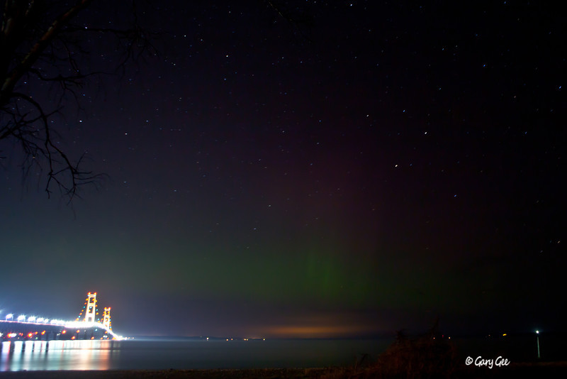 Mackinac Bridge with light glow of northern lights