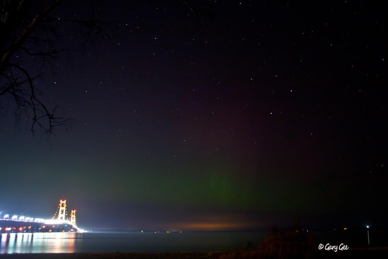 Mackinac Bridge with light glow of northern lights