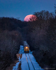 Super Moon rising over freight train