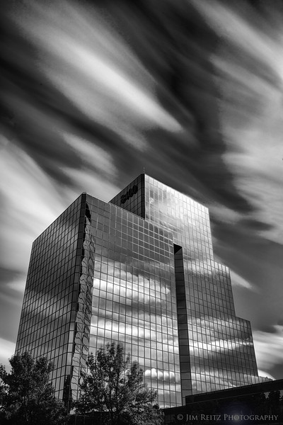 Long-exposure photo of clouds and office building - Bloomington, Minnesota.