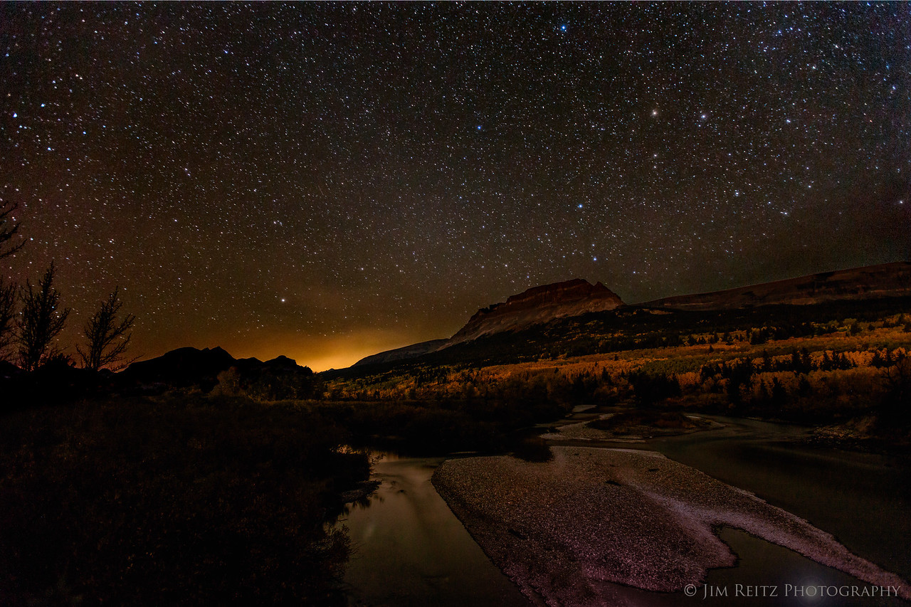 Stars over St. Mary River, Glacier National Park, long exposure. What looks like sunset is actually light pollution from the Columbia Falls/Kalispell area to the west.