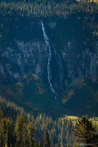 Distant view of 560-foot tall Bird Woman Falls, Glacier National Park