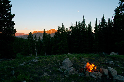 Campfire and moon in the mountains