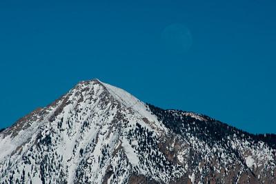 Elk Creek moonrise behind Mt Crested Butte