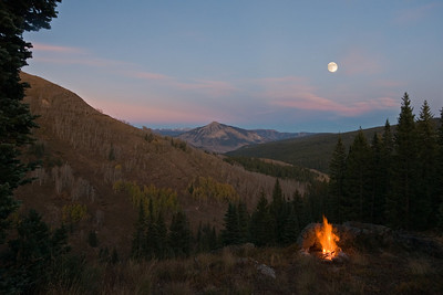 Elk Creek moonrise behind Mt Crested Butte with campfire
