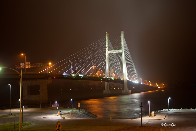 Burlington Iowa bridge over the Mississippi River on a fog filled night