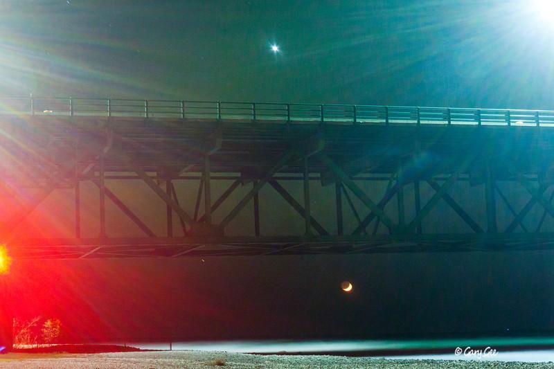 Mackinac Bridge with Northern Lights, Street Lights, Venus & a New Moon