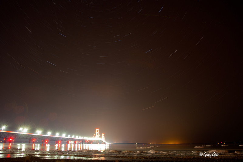 Mackinaw Bridge star trails with floating Icebergs (long exposure...light blow out)