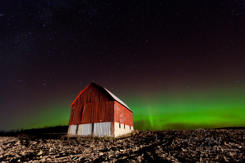 Old barn surrounded by northern lights in Michigan