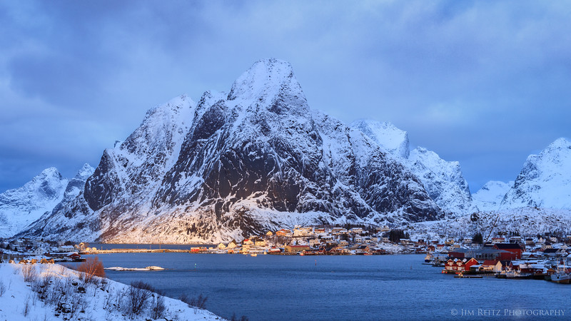 Some hints of sunlight break thru the clouds, in the small town of Reine in Norway's Lofoten archipelago.