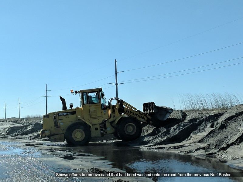 Shows efforts to remove sand that had beed washed onto the road from the previous Nor' Easter.