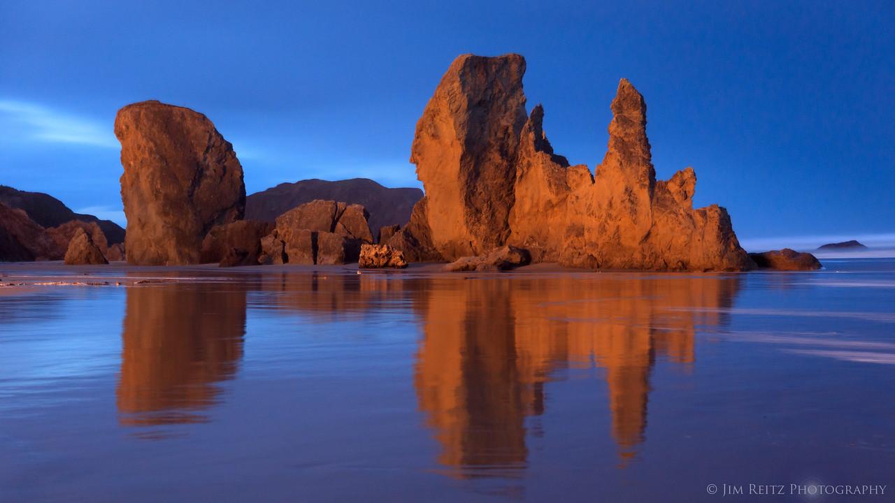 Pre-dawn reflections on Bandon Beach, Oregon.
