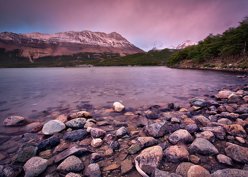 Some brief pink sunrise light at an otherwise-gloomy morning at Lake Capri near El Chalten, Patagonia.
