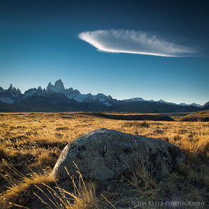 A rock shape is echoed in the cloud above, while Mount Fitz Roy looks on. Near El Chalten, Argentina