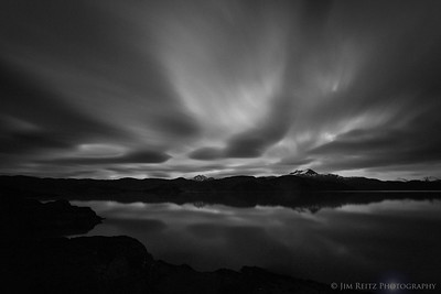 Streaking clouds at sunset on Lake Pehoe, in Patagonia, Chile
