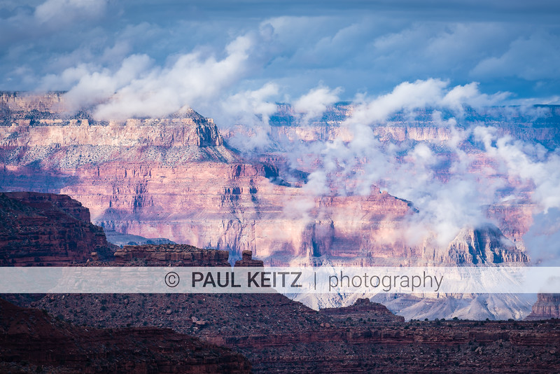 Taken at the rim just before the family and I headed down the Bright Angel trail.  The storm that brought the previous day's snow to the canyon was still present but slowly breaking up and allowed the sun to peak under the clouds to illuminate the walls of the canyon.  As we hiked down the trail, we could see that the clouds rising up originated at the canyon floor which seemed covered in fog.  The upper portions the trail were covered in snow and ice and we needed ice cleats for our trail shoes on the way down to maintain some sort of grip.  We hiked down a couple of miles to an overlook, then headed back.  It's quite a steep hike out.
