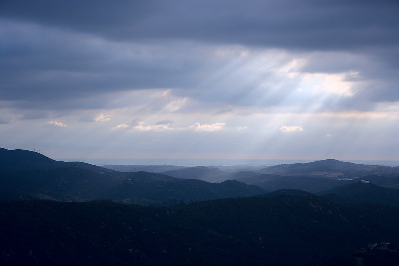 Clouds with rays and hills