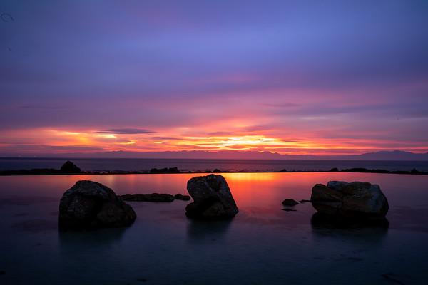 Glencairn tidal pool sunrise outdoor swim, Cape Town, South Africa.