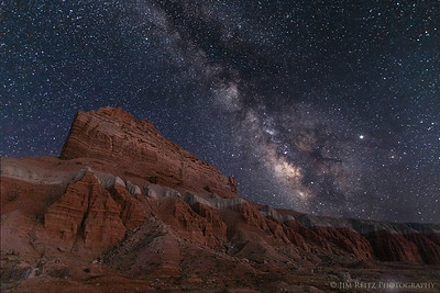 Wild Horse Butte in Goblin Valley State Park, with the Milky Way rising overhead.