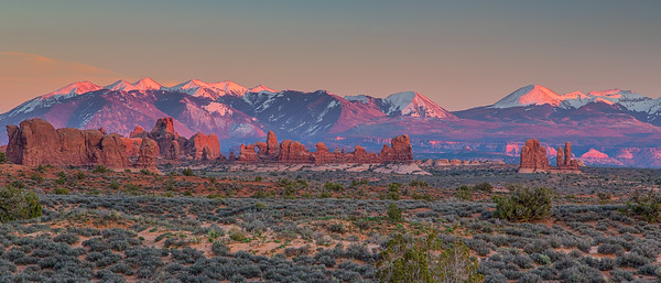 Distant arches & rock formations resemble a city skyline at sunset. Arches National Park.
